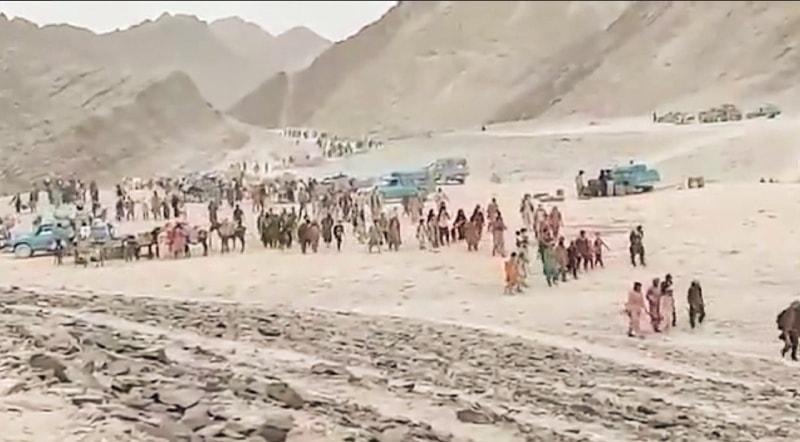 Screengrabs of a video uploaded on Twitter that shows thousands of Afghans fleeing Afghanistan via Pakistan   Kiran Sharifi/Twitter