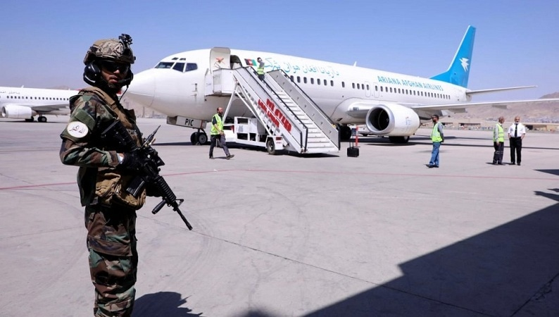 In this file photo, a member of Taliban forces stands guard next to a plane that arrived from Kandahar at Hamid Karzai International Airport in Kabul on Sept 5, 2021. — Reuters