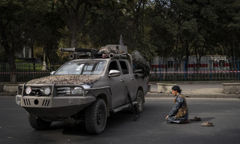 A Taliban fighter prays next to a demonstration organised by the Afghan Society of Muslim Youth, demanding the release of frozen international money in Kabul, Afghanistan in this Sept 24 file photo. — AP