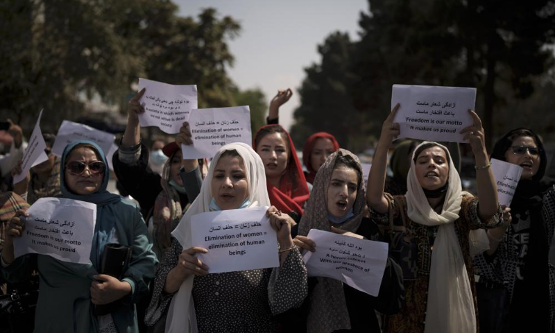 Afghan women march to demand their rights under the Taliban rule during a demonstration near the former Women's Affairs Ministry building in Kabul, Afghanistan on Sept 19. — AP/File
