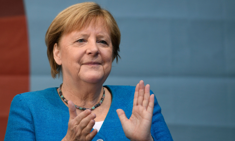 German Chancellor Angela Merkel applauds during a campaign rally for Christian Democratic Union CDU leader and chancellor candidate Armin Laschet (not pictured) in Aachen, western Germany, on Saturday. — AFP