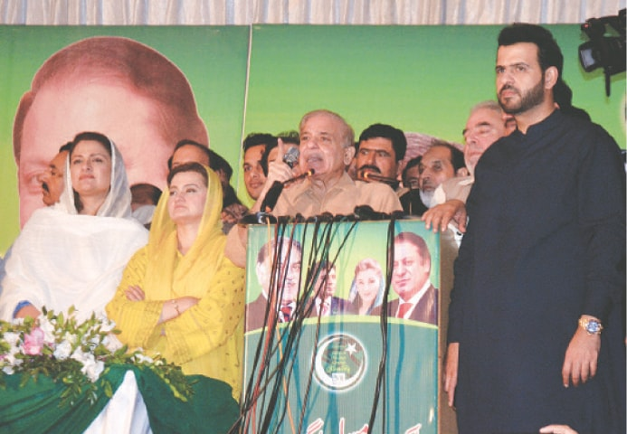 PML-N president Shehbaz Sharif speaks at a convention of party workers in Rawalpindi on Sunday.—White Star