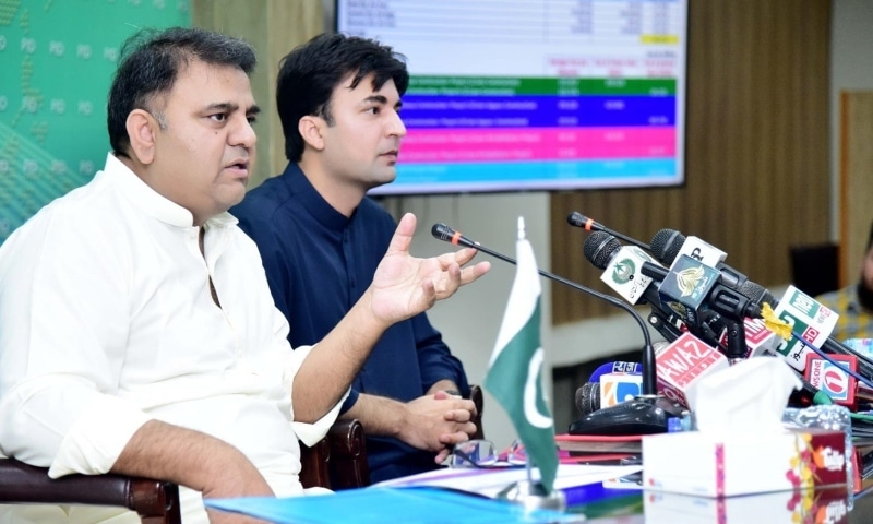 Minister for Information and Broadcasting Chaudhry Fawad Hussain (left) and Minister for Communications and Postal Services Murad Saeed address a press conference on Sunday. — Photo courtesy: PID