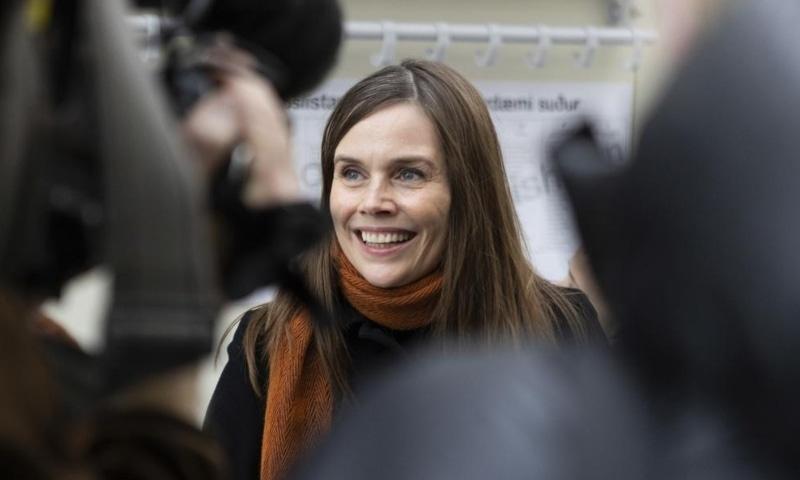 Iceland's Prime Minister Katrin Jakobsdottir speaks to the media after voting at a polling station in Reykjavik on Sept 25. — AP