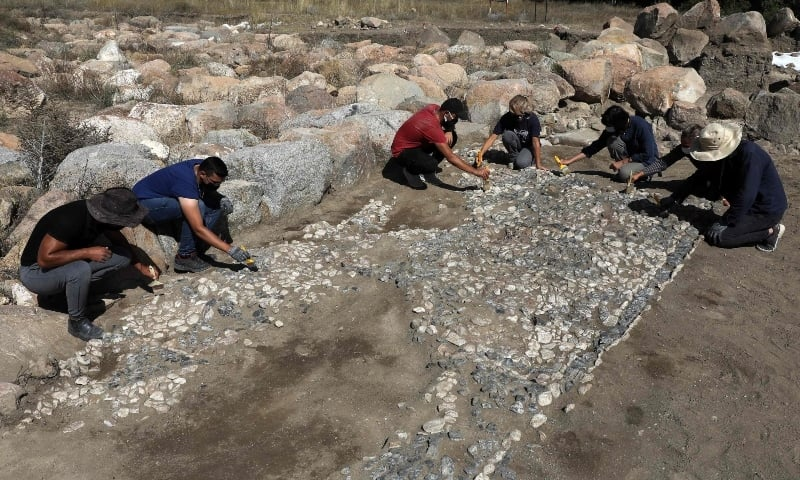 ARCHAEOLOGISTS working on the 3,500-year-old paving stones discovered in Turkey's Yozgat province.—AFP