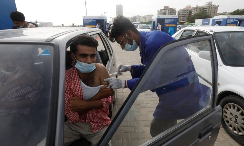 A resident receives a dose of coronavirus disease vaccine at a drive-through vaccination facility in Karachi on August 3. — Reuters