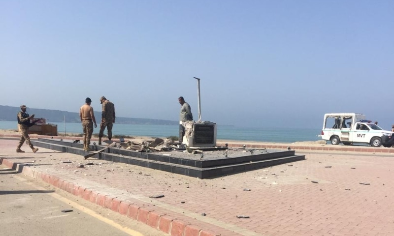 Officials examine the remains after a statue of statue of Quaid-i-Azam Mohammad Ali Jinnah was destroyed in a bomb attack on Sunday. — Photo provided by Ghalib Nihad