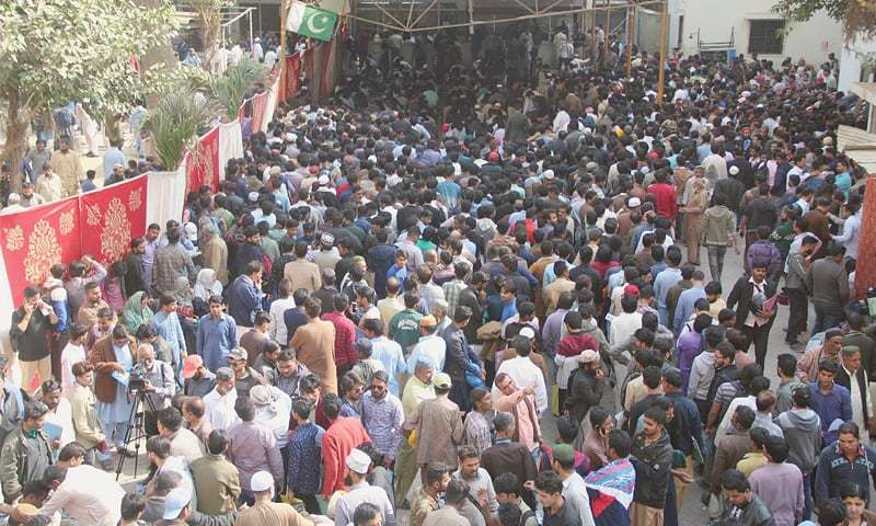 In this file photo, job candidates pack the area enclosed for them on the premises of the Civil Hospital Karachi on Jan 13, 2019.—Online/File