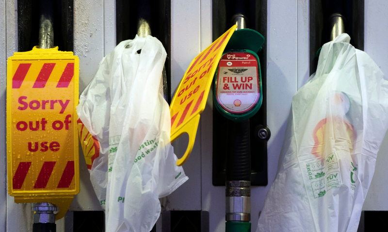 Closed pumps are seen on the forecourt of a petrol station which has run out of fuel after an outbreak of panic buying in the UK, in Manchester, England, on Monday. — AP
