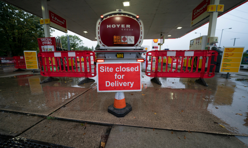 A fuel delivery is made to a petrol station which had run out of fuel after an outbreak of panic buying in the UK, in Manchester, England, on Monday. — AP