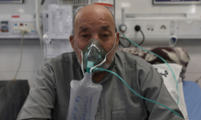 Afghan citizen Zamen Mousavi, a Covid-19 patient breathes with oxygen mask at the Covid-19 ICU ward of Amir Al-Momenin hospital in the city of Qom in Iran. — AP