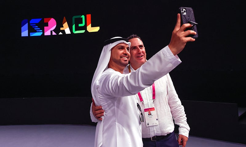 A visitor takes a selfie with Mehach Gantz, a representative of the Israel pavilion during a media tour ahead of the opening of the Dubai Expo 2020 on September 27. —  AFP
