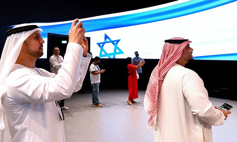 People take pictures in the Israel pavilion during a media tour ahead of the opening of the Dubai Expo 2020 on September 27. — AFP