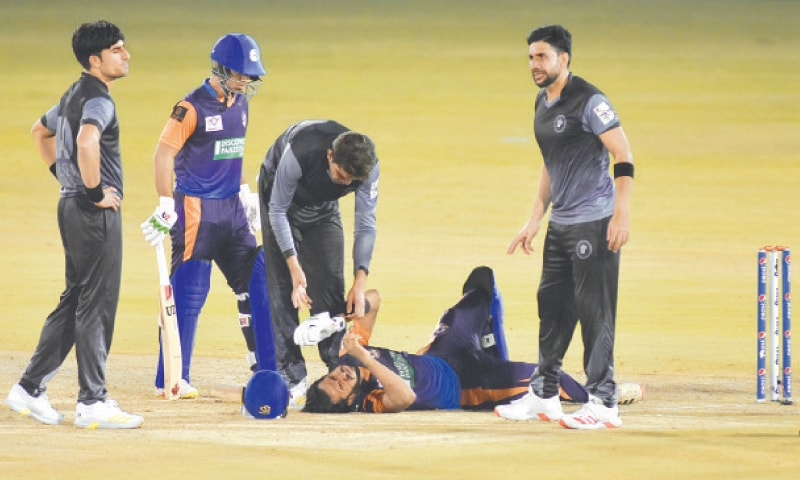 RAWALPINDI: Central Punjab's Hasan Ali lies on the pitch after taking a painful blow on the knee during the match against Khyber Pakhtunkhwa at the Pindi Cricket Stadium on Sunday night.—Tanveer Shahzad/White Star