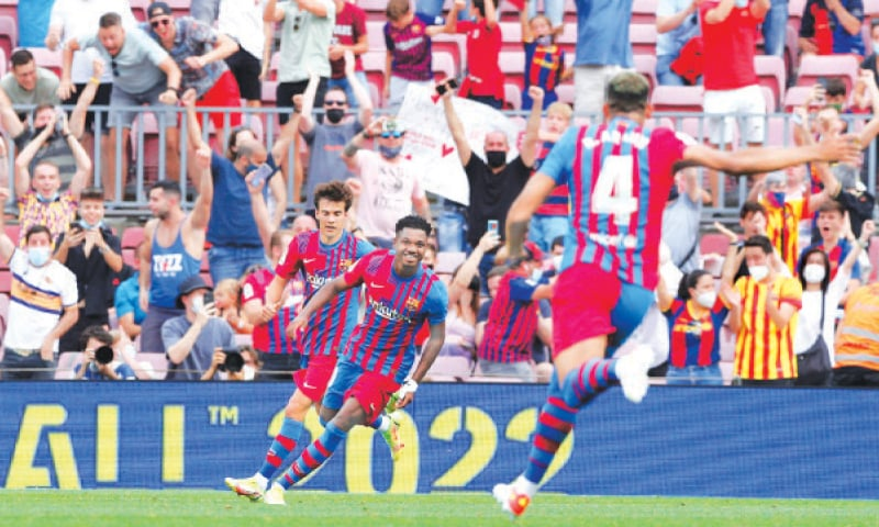 BARCELONA: Barcelona's Ansu Fati (C) celebrates with team-mates after scoring during their La Liga match against Levante at the Camp Nou.—Reuters