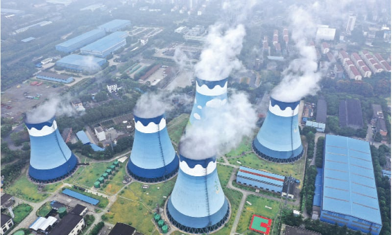 STEAM billows out of the cooling towers at a coal-fired power station in Nanjing, in eastern China's Jiangsu province, on Monday.—AP
