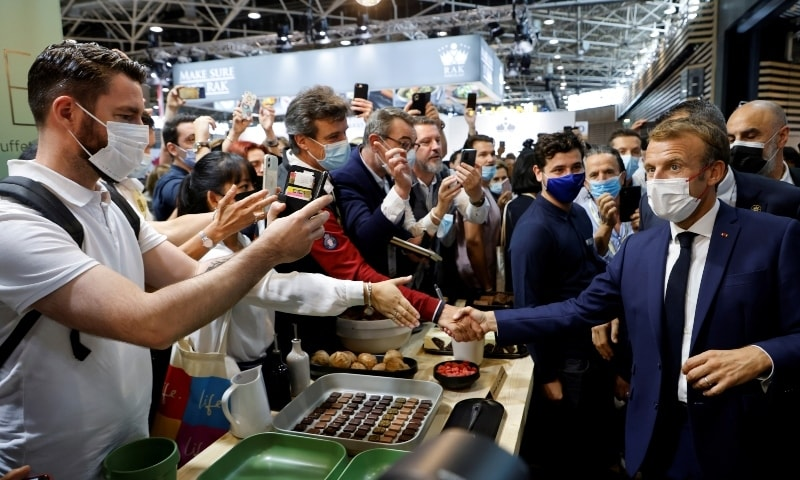 French President Emmanuel Macron meets visitors during his visit to the International Catering, Hotel and Food Trade Fair (SIRHA) in Lyon on September 27. — Reuters