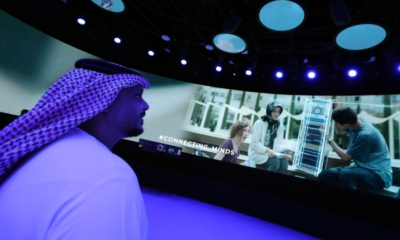 A journalist watches a show of the Israeli pavilion during a media tour at the Dubai Expo on September 27. — AP