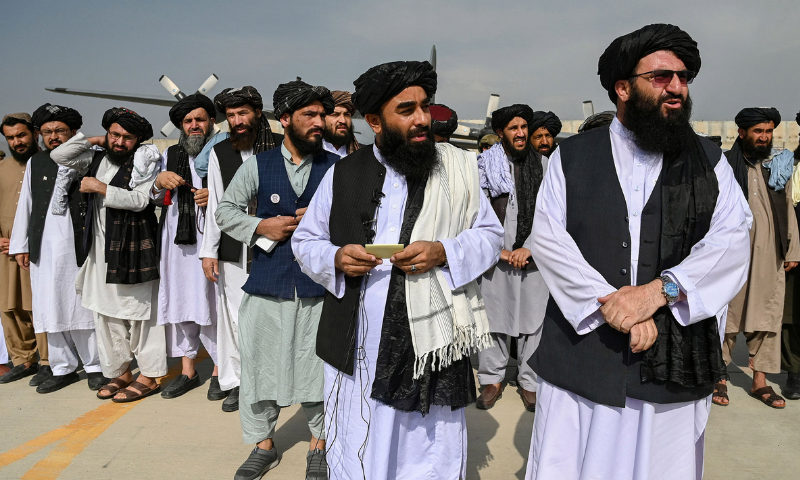 In this file photo, Taliban officials stand on the tarmac of Kabul airport after the withdrawal of US troops from Afghanistan. — AFP
