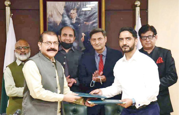 Pakistan Baitul Mal Managing Director Zaheer Abbas Khokhar and Ali Medical Centre Chairman Dr Ali Raza Alvi exchange documents after signing an MoU for provision of cochlear implants for the deaf and mute children on Tuesday. — APP