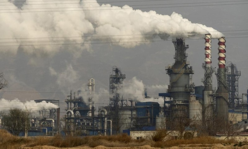 Smoke and steam rise from a coal processing plant in Hejin in central China's Shanxi Province, Nov 28, 2019. — AP/File