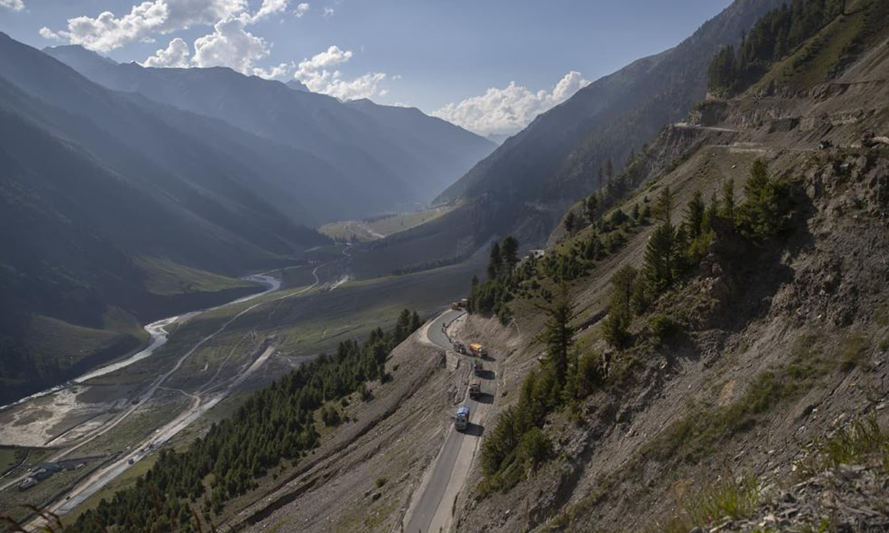 Vehicles run through the Zojila Pass northeast of Srinagar in Indian-occupied Kashmir. — AP