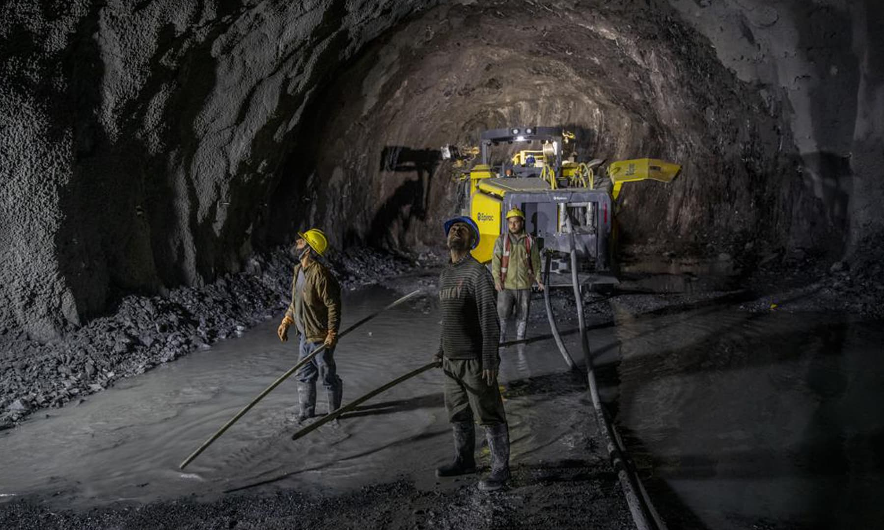 Workers employed by the Megha Engineering And Infrastructures Limited work inside the Nilgrar Tunnel in Baltal area, northeast of Srinagar in Indian-occupied Kashmir. — AP