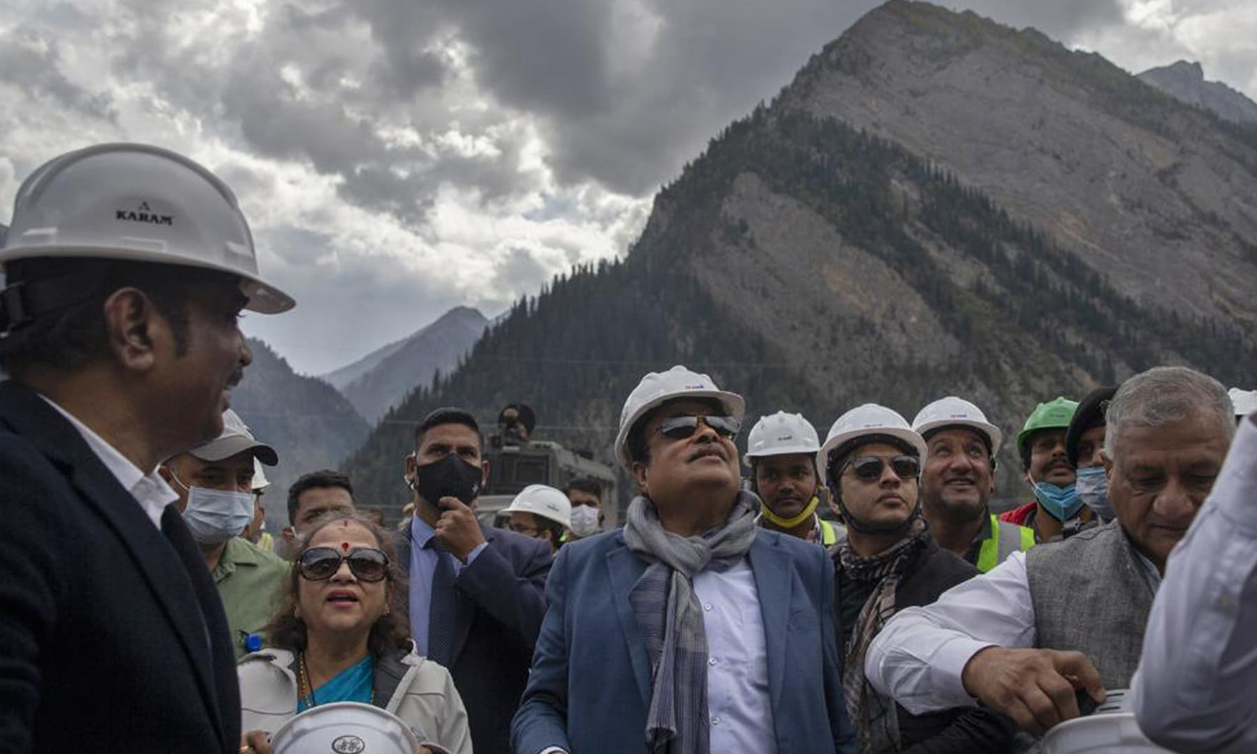 Indian Transport Minister Nitin Gadkari (centre) accompanied by his wife looks at the under construction Zojila tunnel in Baltaal, northeast of Srinagar in Indian-occupied Kashmir. — AP