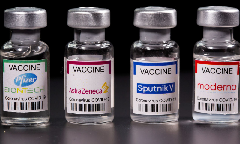 Vials with Pfizer-BioNTech, AstraZeneca, Sputnik V, and Moderna coronavirus vaccine labels are seen in this illustration. — Reuters/File