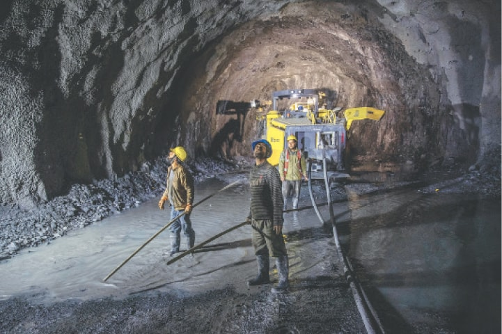 LABOURERS at work inside a tunnel in Baltal, north-east of Srinagar.—AP