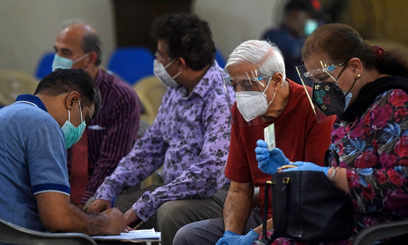 This file photo shows citizens waiting to get vaccinated against the coronavirus in Karachi. — AFP/File