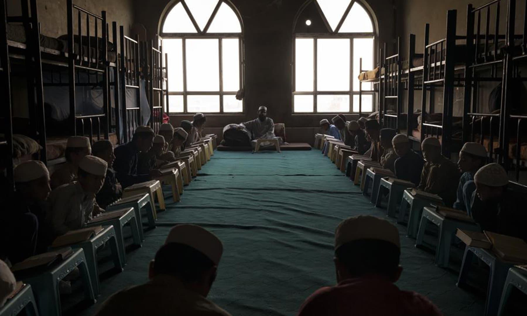 Afghan boys read the Holy Quran at the Khatamul Anbiya madressah in Kabul, Afghanistan. — AP