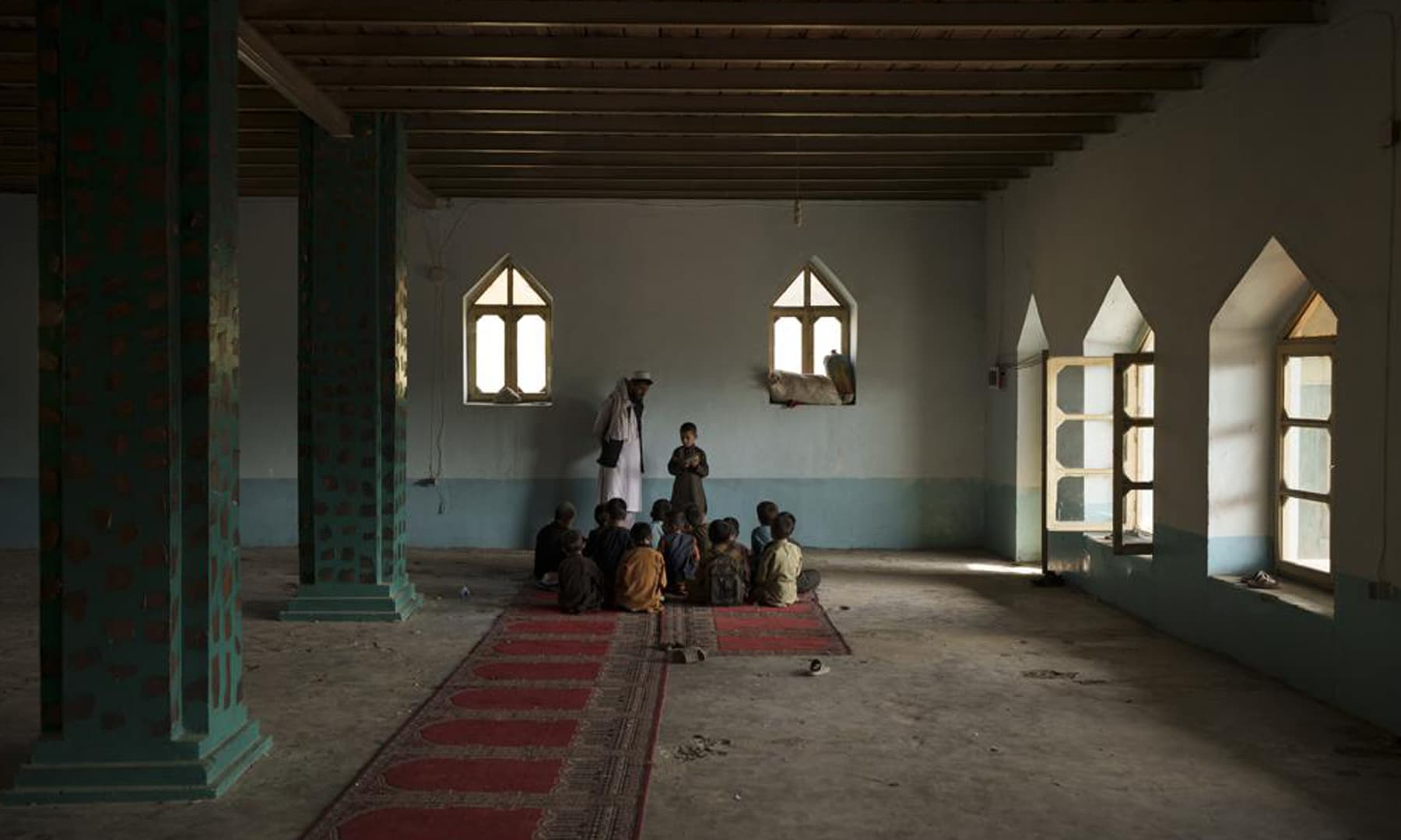 Afghan students read the Holy Quran at a madressah in Kabul, Afghanistan. — AP