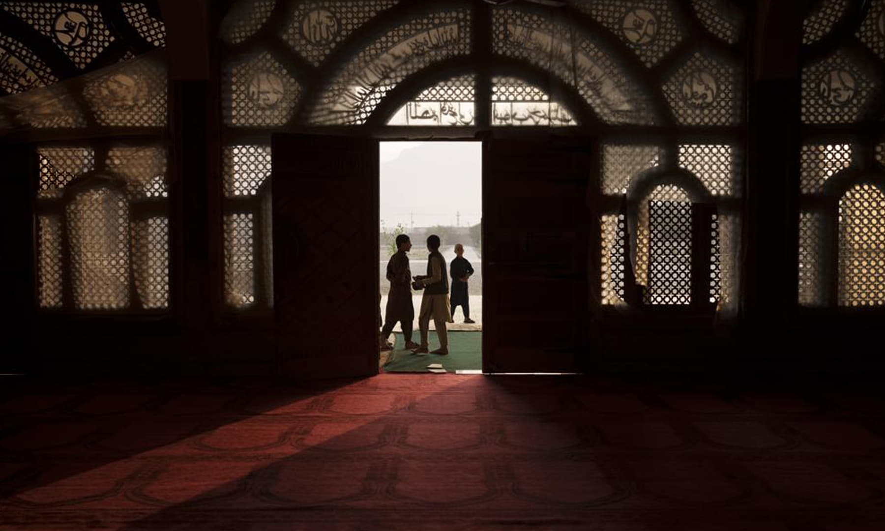 Afghan students walk out of the mosque at the Khatamul Anbiya madressah after morning prayers in Kabul, Afghanistan. — AP