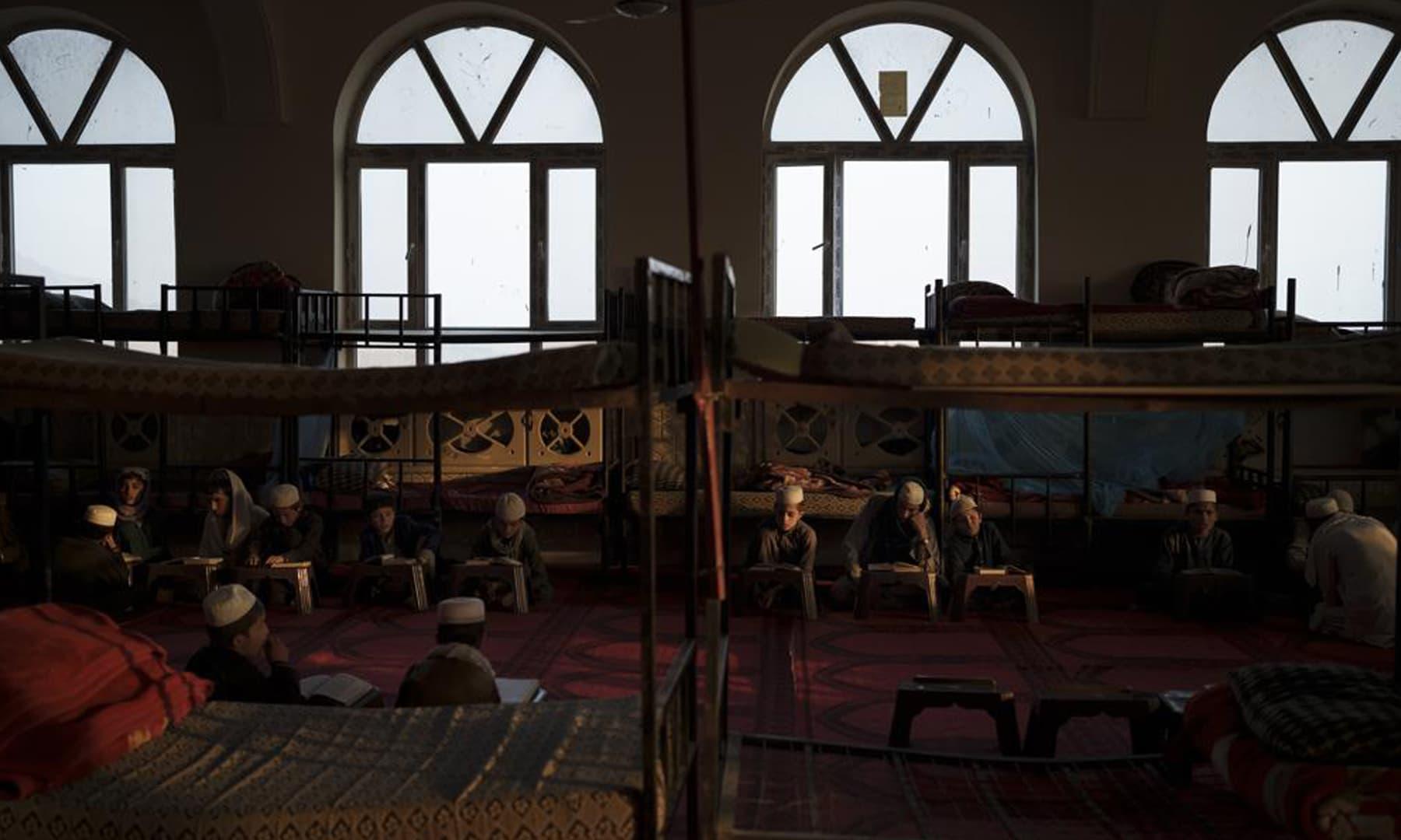 Afghan boys read the Holy Quran during class at the Khatamul Anbiya madressah in Kabul, Afghanistan. — AP
