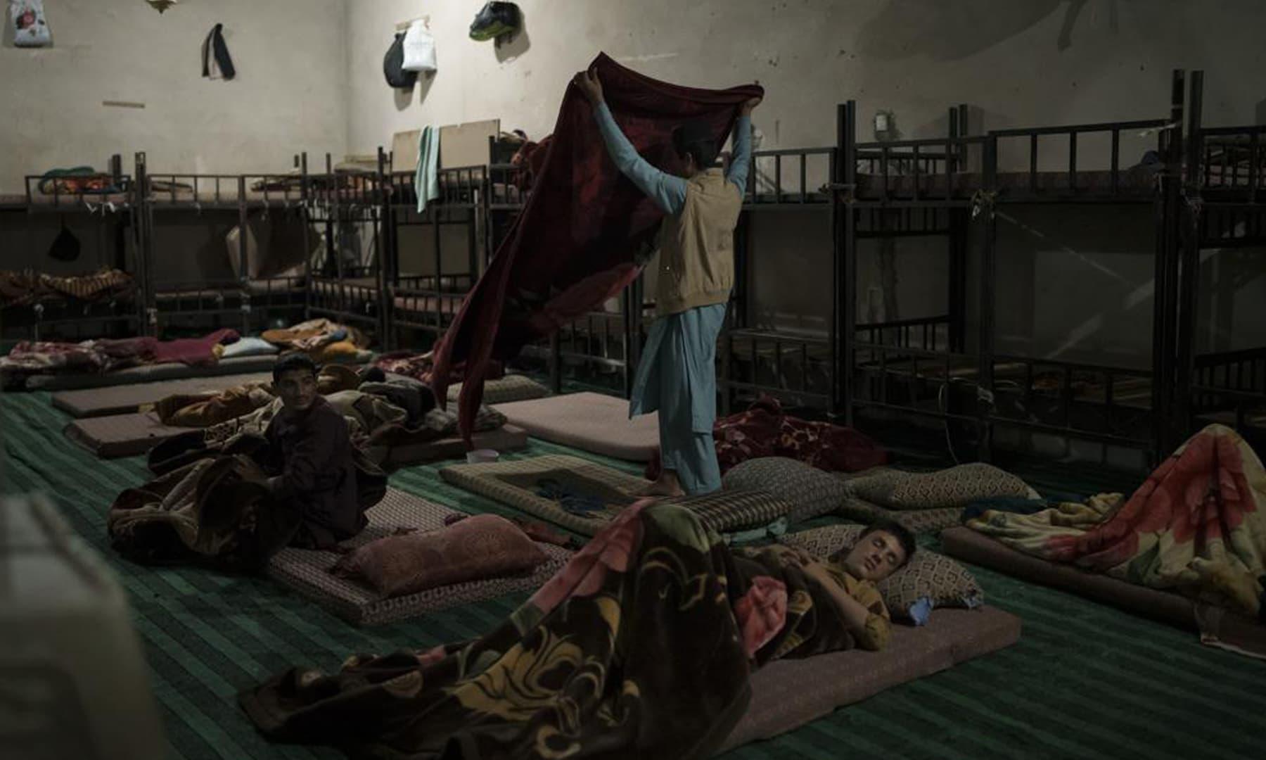 Afghan students wake up before the morning prayer at the Khatamul Anbiya madressah in Kabul, Afghanistan. — AP