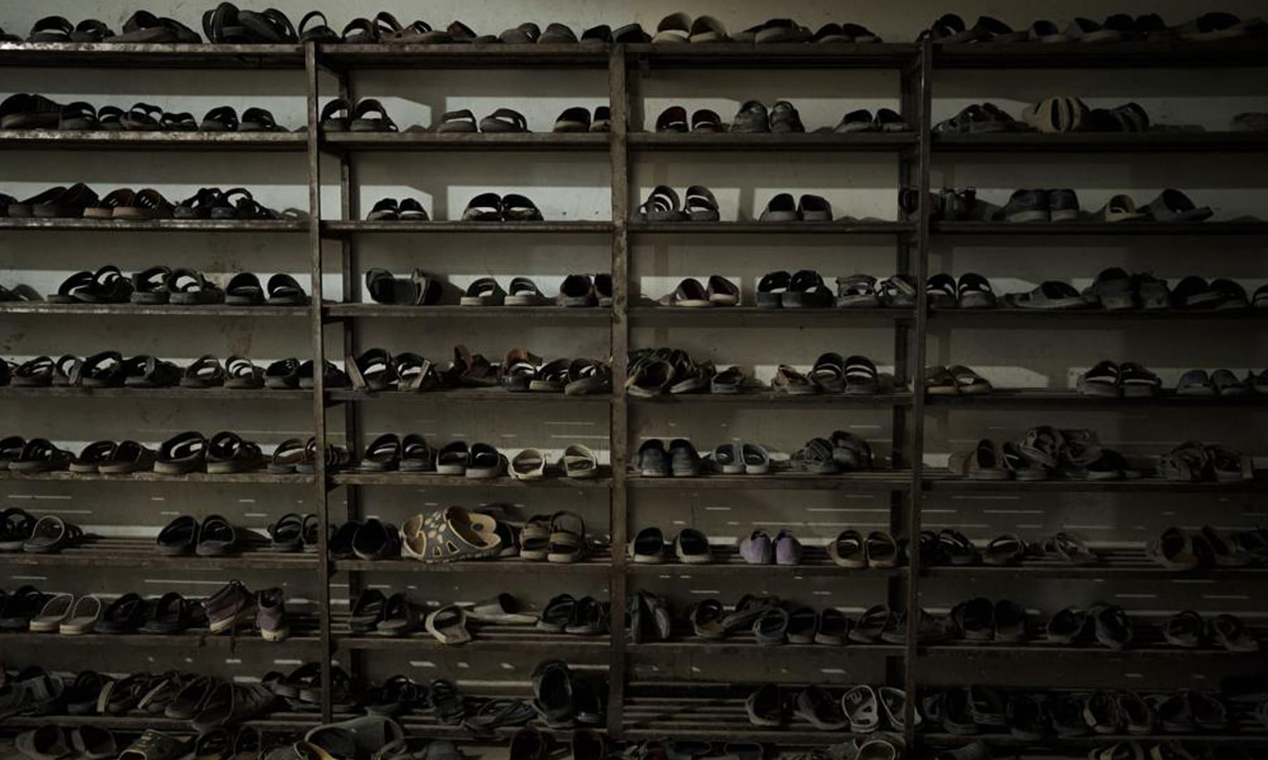 Shoes of students are placed at the entrance of the dining hall of the Khatamul Anbiya madressah in Kabul, Afghanistan. — AP