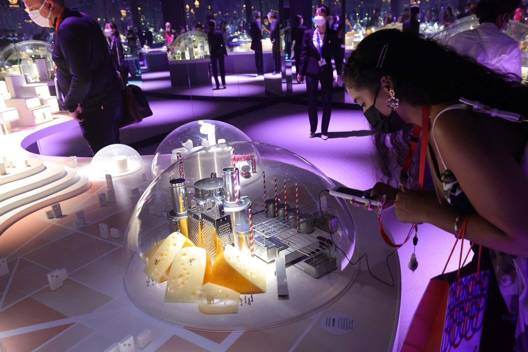 A visitor snaps a picture with her telephone of an object exposed inside the Japanese pavilion at the Expo 2020. — AFP