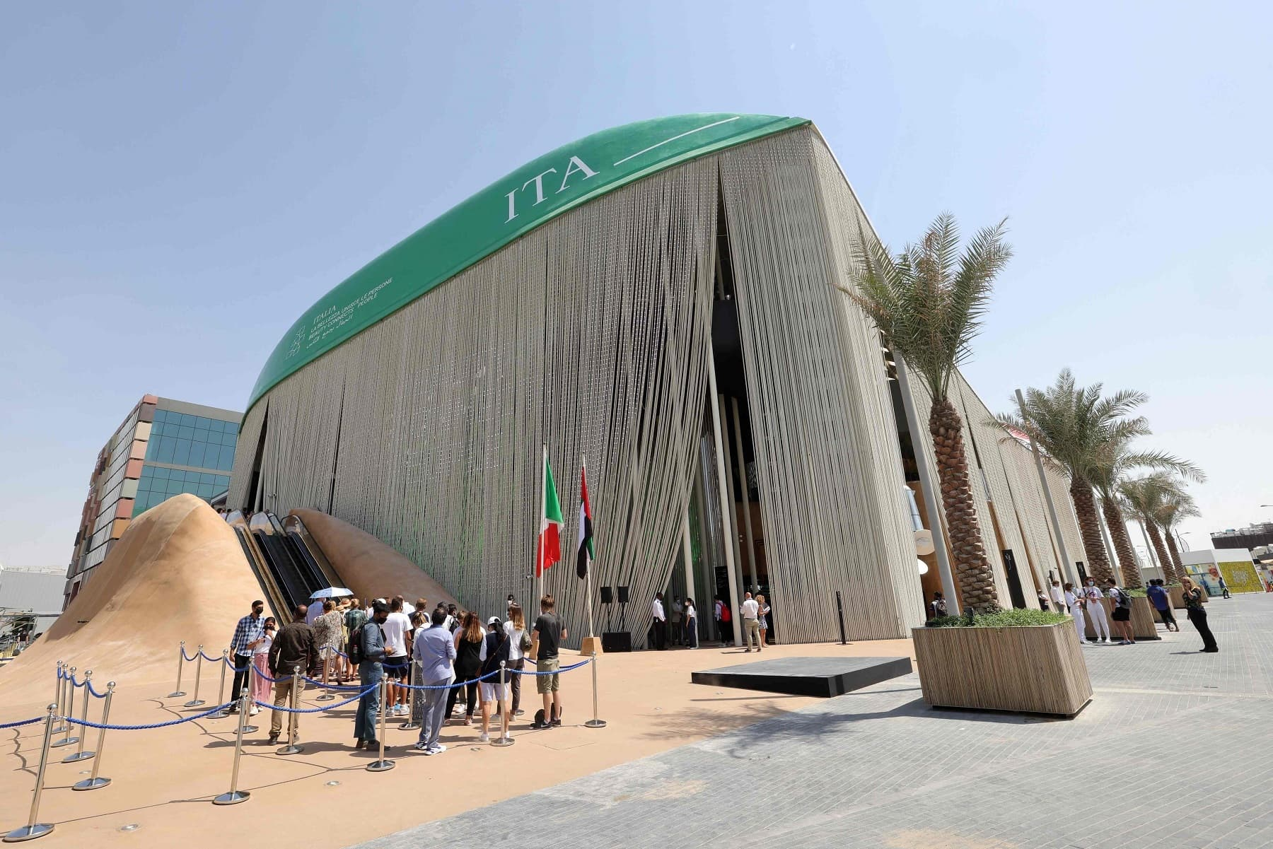 Visitors gather in front of the Italian pavilion at the Expo 2020, in the Gulf Emirate of Dubai on Friday. — AFP