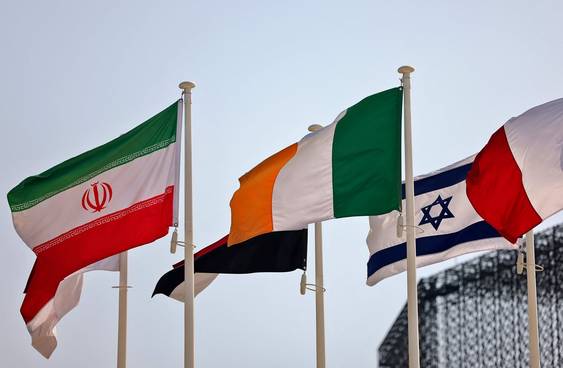 Iranian and Israeli flags are pictured near each other at the Dubai Expo 2020. — AFP