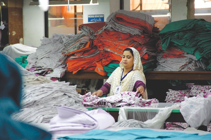 A file photo shows a woman working at a garment factory in Karachi | Hussain Afzal/White Star