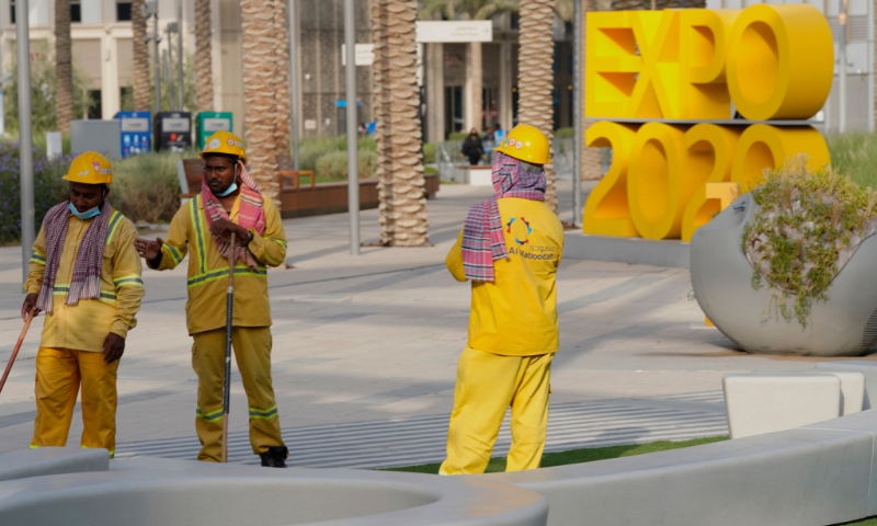 Workers clean an area at Expo 2020 in Dubai, United Arab Emirates, on Sunday. — AP