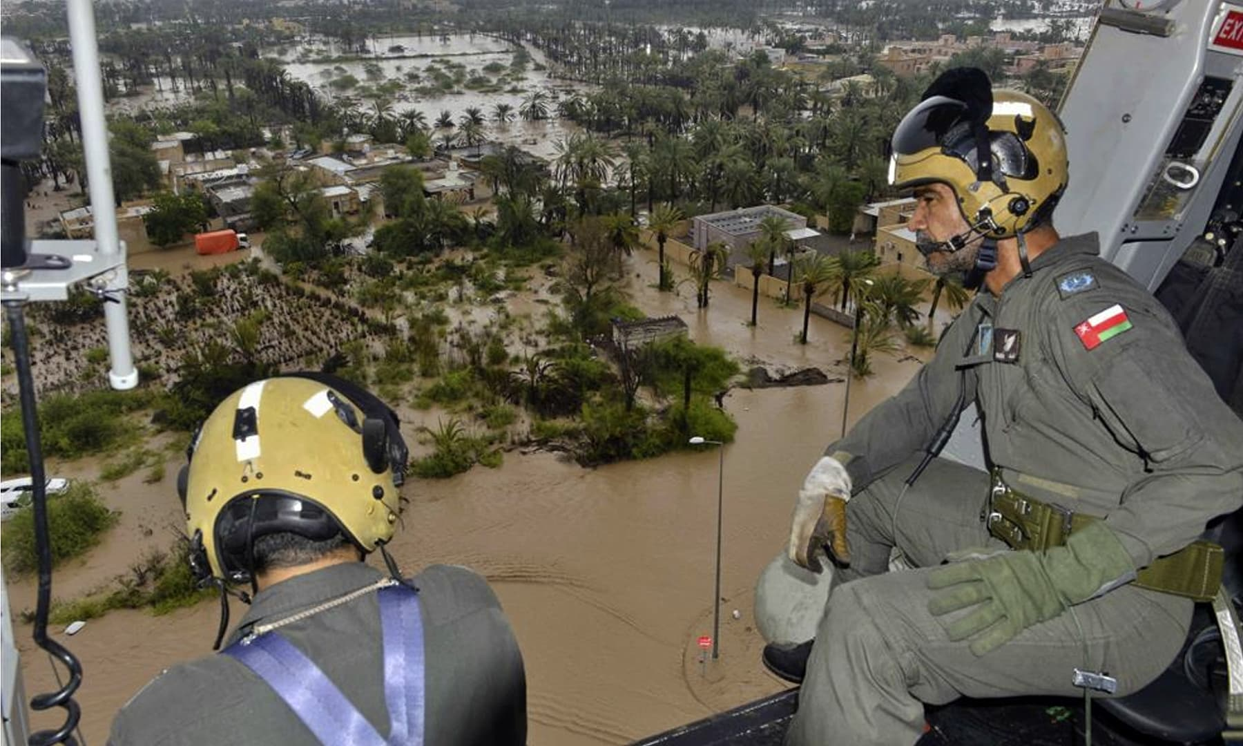 Oman Air Force personnel fly over the Al Khaburah district to assess damage from Cyclone Shaheen, in Oman, Monday, Oct 4. — Oman News Agency via AP