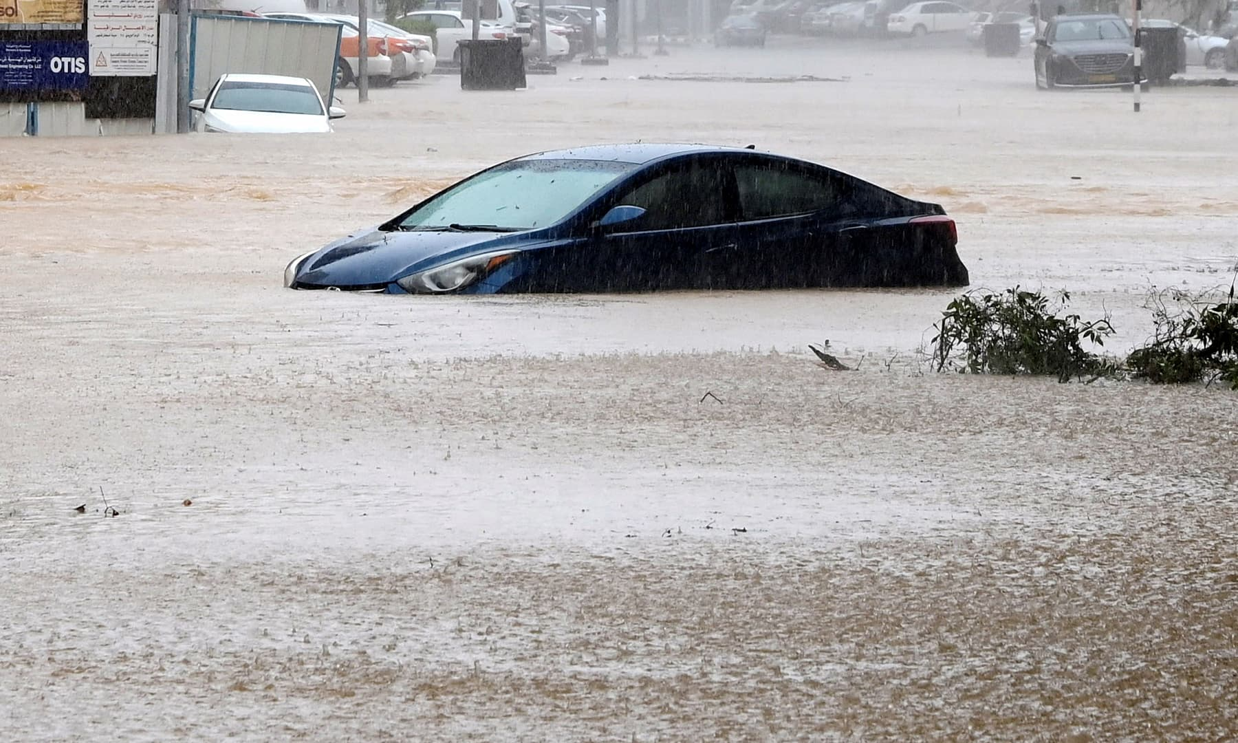 A car is partially submerged on a flooded street as Cyclone Shaheen makes landfall in Muscat, Oman, October 3. — Reuters