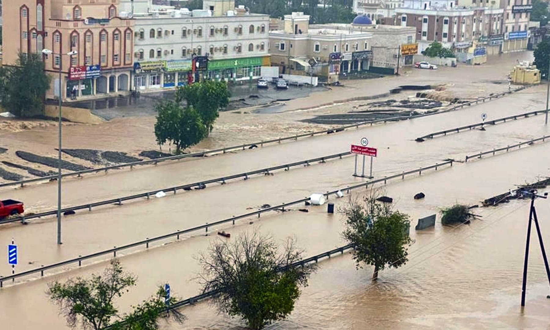 A flooded street of the Al Khaburah district is seen after Cyclone Shaheen, in Oman, Monday, Oct 4. — Oman News Agency via AP