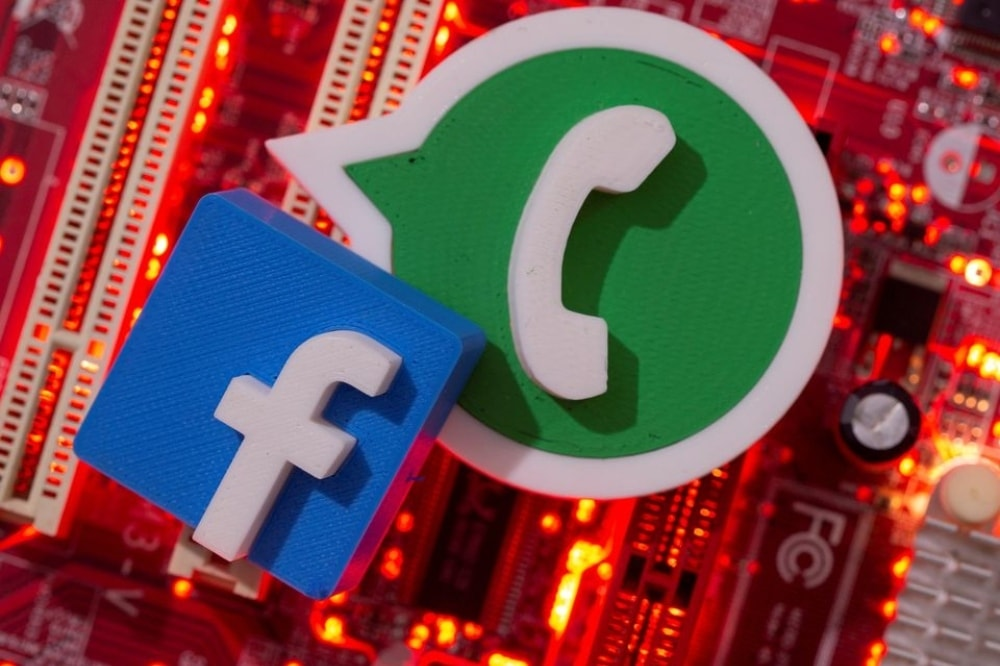 3D printed WhatsApp and Facebook logos are placed on a computer motherboard in this illustration taken January 21. — Reuters