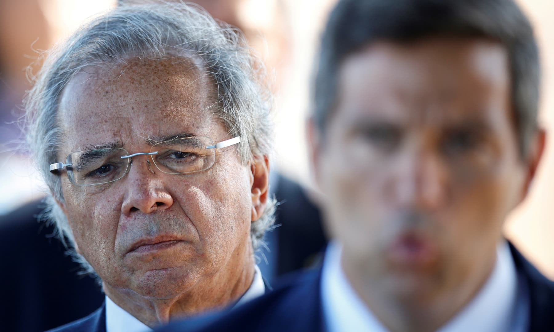 Brazil's Economy Minister Paulo Guedes listens to Brazil's Central Bank President Roberto Campos Neto, as he leaves Alvorada Palace in Brasilia, Brazil on April 27, 2020. — Reuters/File
