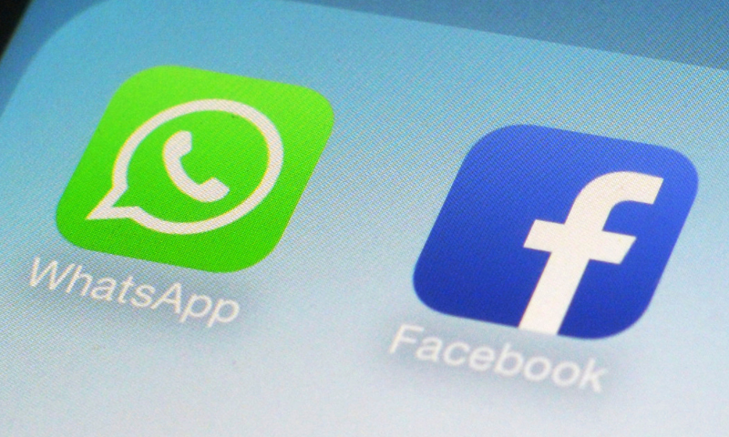 This file photo shows WhatsApp and Facebook app icons on a smartphone in New York. — AP/File