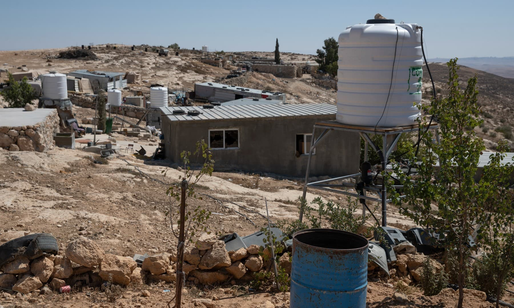 A new water tank rests on a stand after it replaced a damaged one following a settlers' attack from nearby settlement outposts on the Palestinian Bedouin community, in the West Bank village of Al-Mufagara, on Sept 30. — AP