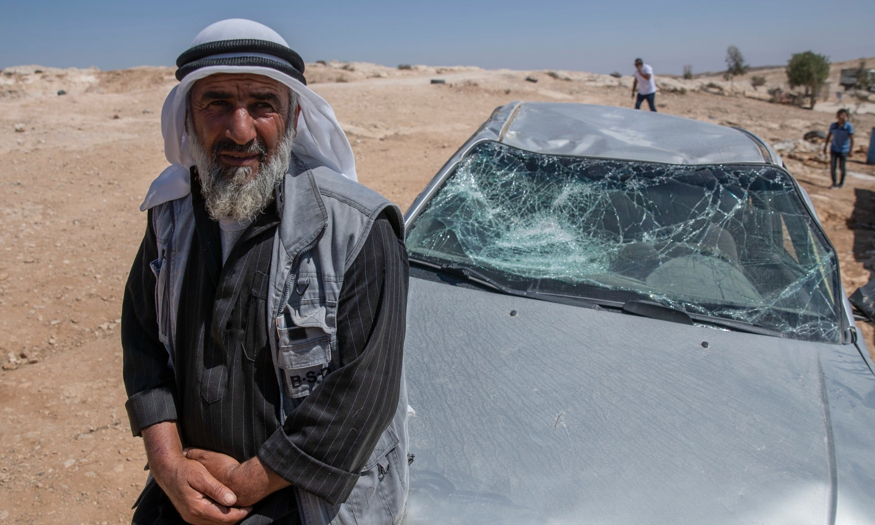 A Palestinian man leans on his smashed vehicle following a settlers attack from nearby settlement outposts on his Bedouin community, in the West Bank village of Al-Mufagara, on Sept 30. — AP